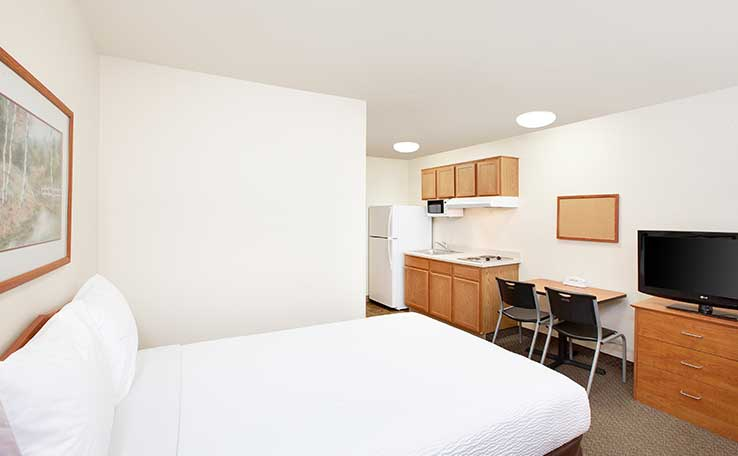Extended Stay Hotels in Denton, TX | WoodSpring Suites