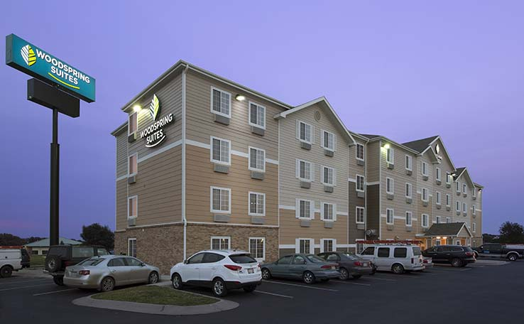 hotel exterior nebraska hotels woodspring extended locations suites lincoln stay photo in professional